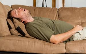 man-sleeping-on-couch-with-mouth-open-1